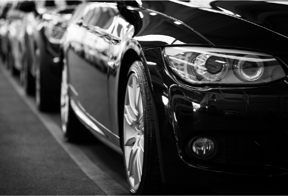 black and white photo of car with parking sensors