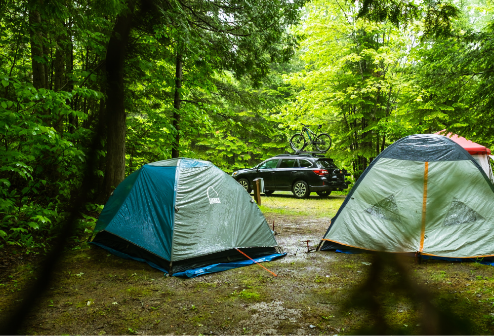 two tents and a car with bike rack